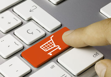 Computer keyboard with shopping cart icon
